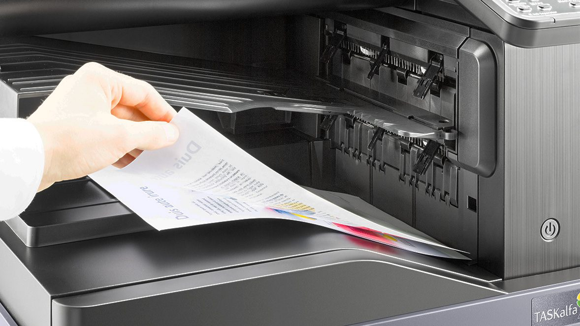 hand retrieving items from a printer